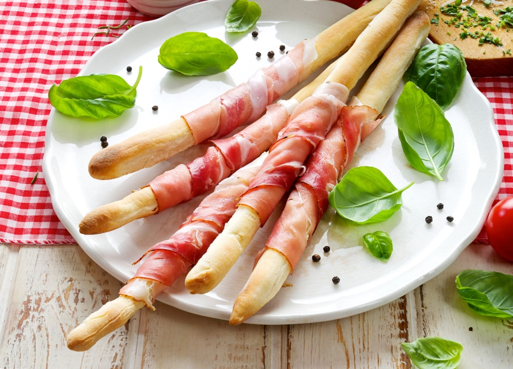 Grissini with prosciutto crudo
